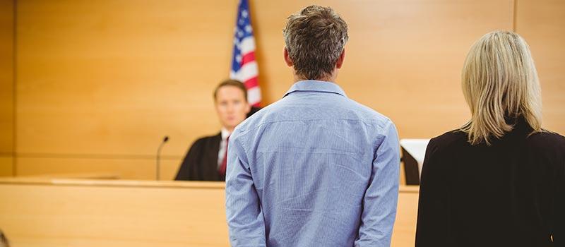 Man Being Sentenced by Judge